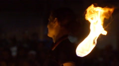 Young girl dancing with fire Stock Footage