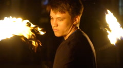 Young man does a fire performance at Fire show Stock Footage