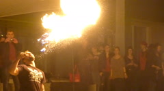 Fire show. Young man firebreathing, girl juggling with fire - stock footage