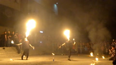 Fire show. Young men firebreathing - slow motion Stock Footage