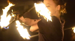 Young girl does a fire performance Stock Footage