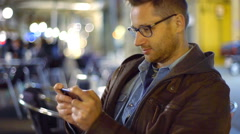 Man playing game and drinking beer in the cafe, steadycam shot Stock Footage