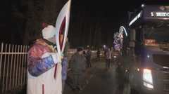 Relay race of Olympic flame in Saint Petersburg. Bus with supporter wave pom pom - stock footage