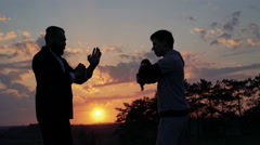 The fighting of Wing Chun on perfect sunset near the river. 4k Stock Footage
