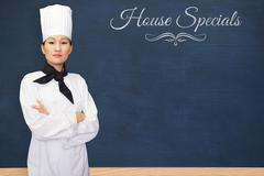 Composite image of portrait of confident female cook in kitchen - stock photo