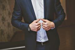 Purple satin tie with black tux. Closeup Stock Photos