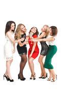 Portrait of joyful friends toasting at New Year party Kuvituskuvat