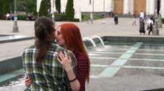 Young couple petting by the fountain Stock Footage