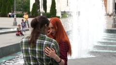 Young couple hugging by the fountain Stock Footage