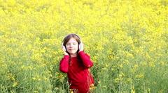 Little girl enjoy in music Stock Footage