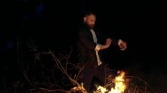 Wing Chun near tne bonfire in black forest. Slowly Stock Footage