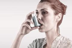 Composite image of portrait of a asthmatic woman - stock photo