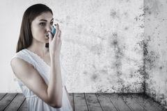 Composite image of portrait of an asthmatic woman - stock photo