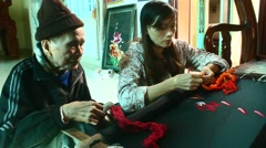 Embroidery artisans are embroidering paintings, Laos Stock Footage