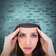 Composite image of pretty brunette with a headache Stock Photos