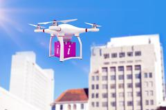Composite image of a drone bringing a pink cube Stock Illustration