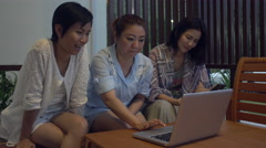 4k medium shot of asian female group resourcing information and talking. - stock footage