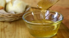 Honey dripping from a spoon Stock Footage