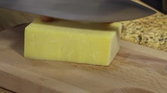 Slicing cheddar cheese Stock Footage