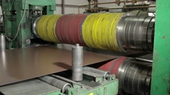 Colored metal sheet is moving across machine Stock Footage