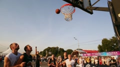 Young athlete men play street basketball on sport field. Summer festival. Two Stock Footage