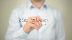 Zero Tolerance , man writing on transparent screen Stock Footage