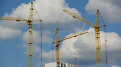 Construction cranes against  sky, taymlaps Stock Footage