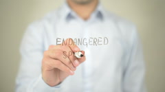 Endangered Species , man writing on transparent screen - stock footage