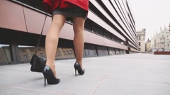 Woman legs in black heeled shoes walking in the city. Stabilized Slow Motion Stock Footage