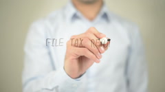 File Tax Return , man writing on transparent screen Stock Footage