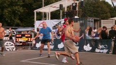 Young athlete men play street basketball on sport field. Summer festival Stock Footage