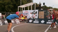 Young boys playing street basketball on sport field. Summer festival. Evening Stock Footage
