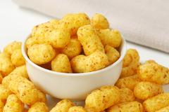 Bowl of crunchy peanut puffs Stock Photos