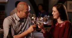 4K Attractive couple on a date, drinking wine and enjoying each other's company Stock Footage