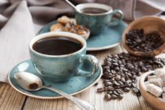 Black coffee and coffee beans Stock Photos