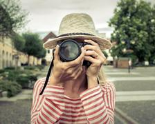 Woman with camera on the street. - stock photo