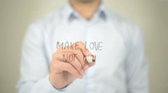 Make Love Not War , man writing on transparent screen Stock Footage