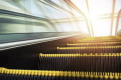 Blurry modern escalator at sunny day. - stock photo