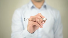 Downsizing , man writing on transparent screen Stock Footage
