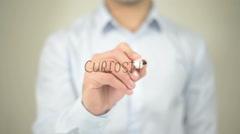 curiosity , man writing on transparent screen - stock footage