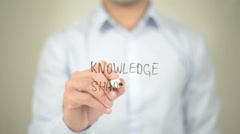 Knowledge Sharing , man writing on transparent screen Stock Footage