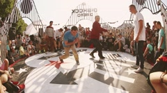 Two boys synchronously dance breakdance on summer contest. Festival. Battle - stock footage