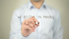 We Believe In Making A Difference , man writing on transparent screen - stock footage