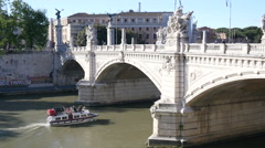 Tiber River boat and a bridge Vittorio Emanuele II in Rome Italy Stock Footage