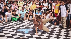Young teen breakdancer make acrobatic freestyle movements on summer contest Stock Footage