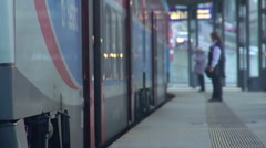 Last passengers running to train, conductor controlling discipline, slowmotion Stock Footage