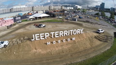 Flying over the Jeep off-road vehicles at test drive Stock Footage