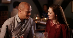 4K Romantic couple enjoying a meal out, man feeds his partner from his plate Stock Footage