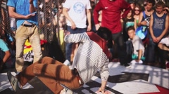 Young breakdancer make acrobatic stunts on summer challenge. Festival. Freestyle Stock Footage