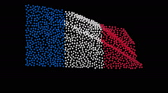 Flag of France, consisting of many balls fluttering in wind, black background. - stock footage